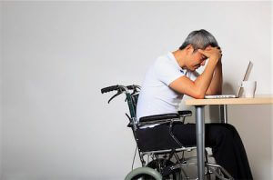 sad-person-in-wheelchair-workers-compensation-lawsuit